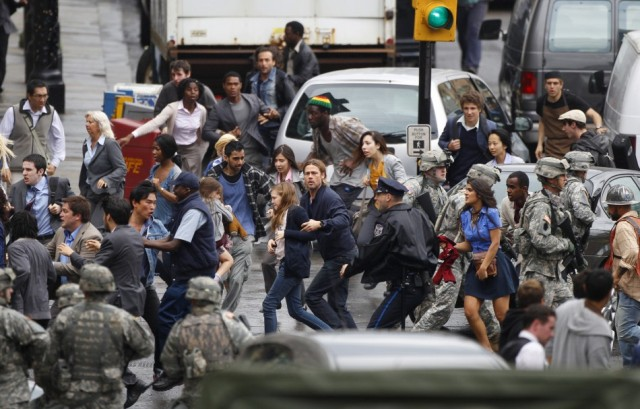 150399-actor-brad-pitt-c-runs-during-the-filming-of-zombie-movie-world-war-z-