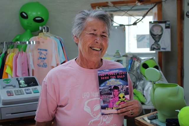 Judy Messoline shows off her book