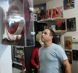 Film buff, Jason, admires the Shield's autographs!