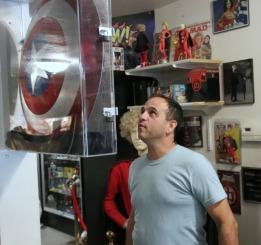 Film buff, Jason, admires the Shield's autographs!